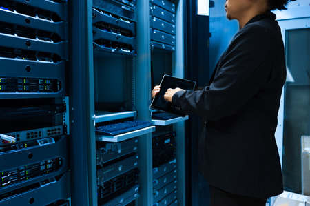 server technology: People fix server network in data room .