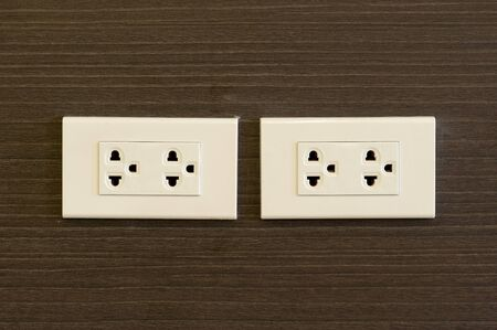 plugged: An Plug socket in modern place .