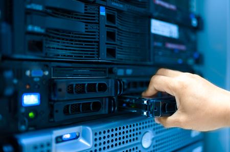 Man fix server network in data center room .