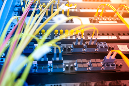 centre: fiber optic with servers in a technology data center . Stock Photo