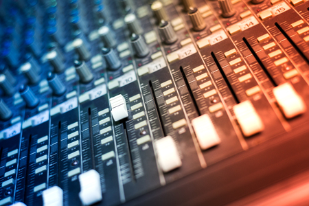 the mixing: An Audio mixing table in soft light .