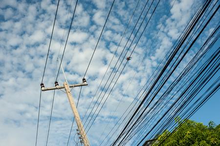 Pillar electric line in sun light .