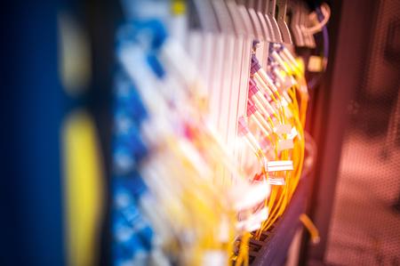 fiber optic with servers in a technology data center . Standard-Bild