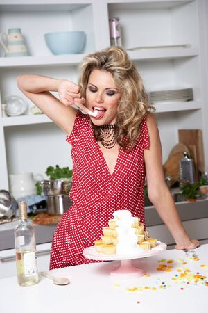 woman in a red dress cooking in a kitchen Stock Photo - 2480442