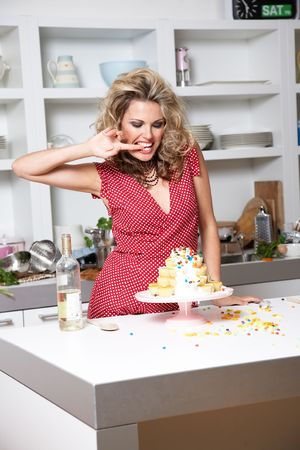 woman in a red dress cooking in a kitchen photo