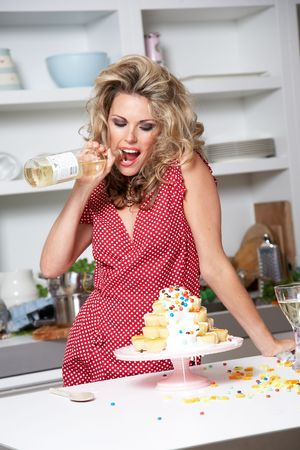 woman in a red dress cooking in a kitchen:  photo