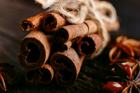 Spices sticks cinnamon on old table. Rustic background, aroma close-up.