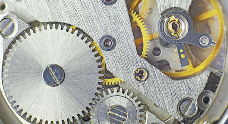hi res: CLose up of cogwheels in a clock machine Stock Photo