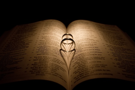 Wedding Ring In Bible With Heart Shadow photo