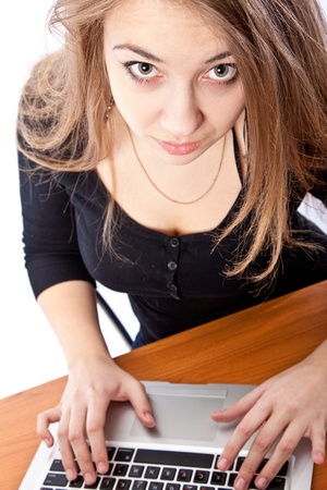 Young beautiful businesswoman with laptop in the office  photo