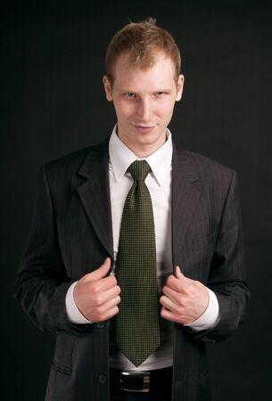 buisness: Portrait adult guy on black backout Stock Photo