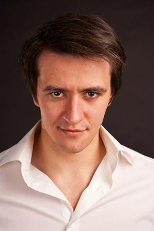 purposeful: Portrait adult man on black background