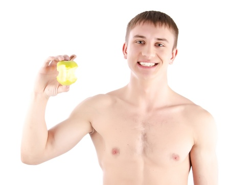 Happy man holding green apple  photo
