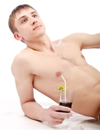 young guy lie with glass in hand, isolated over white  photo