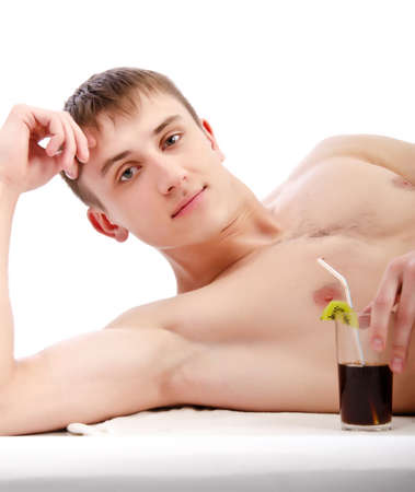 long hair boy: young guy lie with glass in hand, isolated over white  Stock Photo
