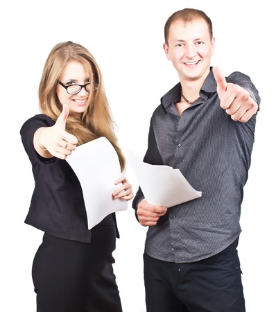 Happy guy and business woman holding their thumbs up. gray gradient background  photo
