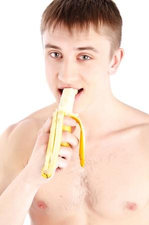 Muscle sexy h�meda joven desnudo comer el pl�tano Foto de archivo - 11812242