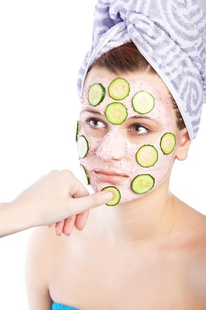 Skincare woman with beauty mask of fresh cucumbers. Arm applying  photo