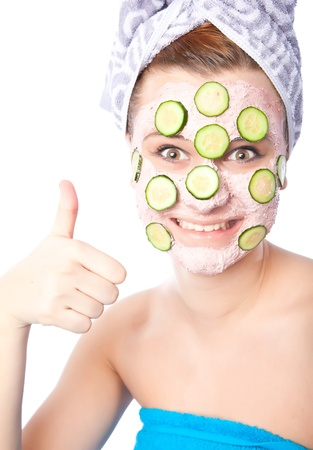 Skincare woman with beauty mask humbs up  photo