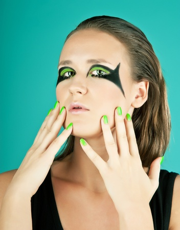Beautiful young model with bright make-up and manicure  photo