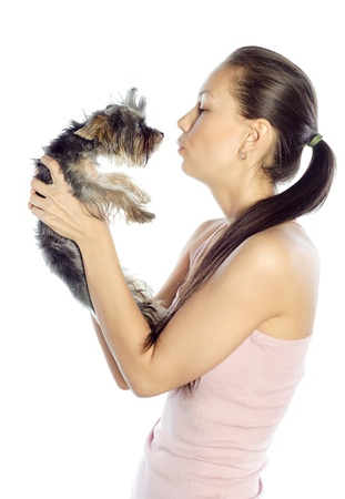 Beautiful girl kissing the dog Stock Photo - 13906233