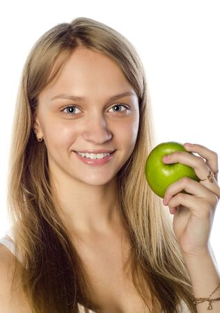 Gorgeous young woman holding a green apple in her hand  photo