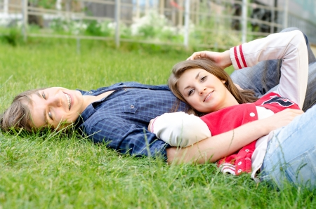 Handsome man and woman lying in the grass  photo