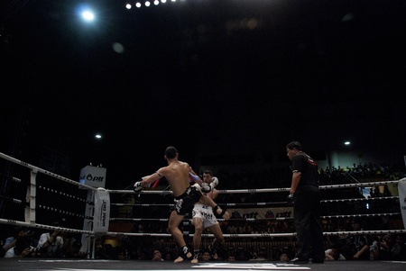 unrivalled: BANGKOK, THAILAND- SEPTEMBER 25: Unidentified players in Thai Fight : Muay Thai.Worlds Unrivalled Fight on September 25, 2011 at Thammasat University Convention Center in Bangkok, Thailand  Editorial