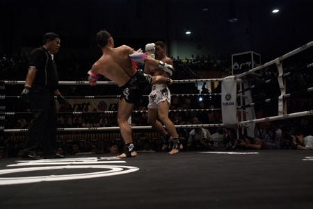 BANGKOK, THAILAND- SEPTEMBER 25: Unidentified players in Thai Fight : Muay Thai.Worlds Unrivalled Fight on September 25, 2011 at Thammasat University Convention Center in Bangkok, Thailand