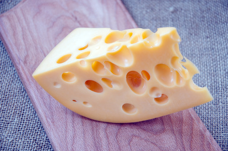 chees: Emmental cheese from cows milk, with big holes