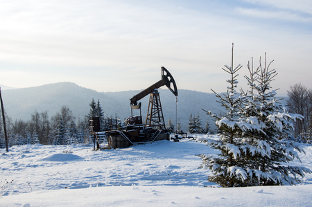 extraction of oil: Rig for extraction oil , on  snow in the mountains