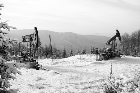 brent crude: Rig for extraction oil , on  snow in the mountains