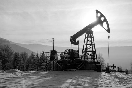 Rig for extraction oil , on  snow in the mountains