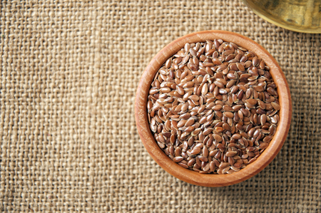 organic flax seed: linen used in cooking and in the textile industry and medicine Stock Photo