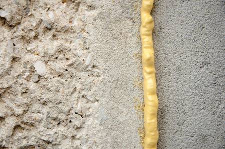 pu foam: polyurethane foam filled crack in the wall