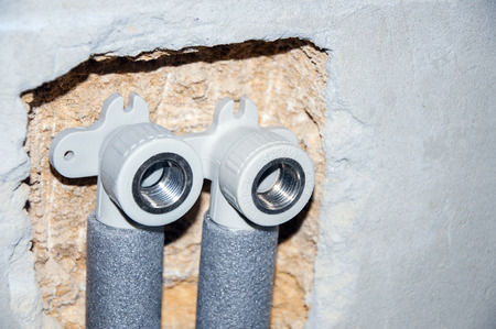 Installing pipes for water supply, heating, sanitation. Workplace plumbing in construction. Installing plumbing. Stock fotó