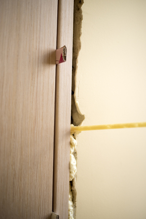 Installation of doors using polyurethane foam mounting. Cylinder Foam. Small depth of field