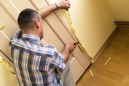 polyurethane: Master knife cuts off excess mounting foam. Installation of doors using polyurethane foam mounting.