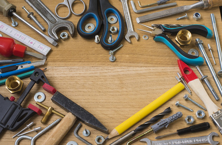 Happy fathers day:  tools, symbol heart, on wooden background. Construction concept Stock fotó