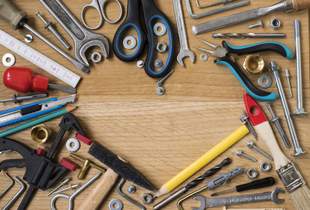 screw jack: Happy fathers day:  tools, symbol heart, on wooden background. Construction concept Stock Photo