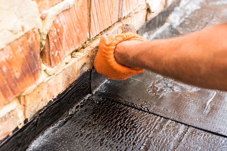 blowtorch: Once sealed together, roll waterproofing, close up. Professional master , making waterproofing. Installation of roll roofing waterproofing propane blowtorch during construction.