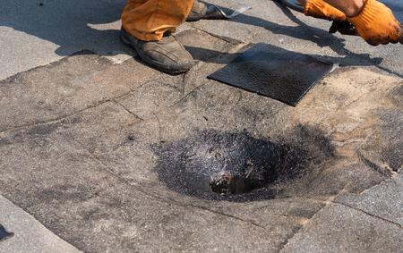 bitumen felt: Roofer doing repair  roof drain. Flat roof installation. Heating and melting bitumen roofing felt. Flat roof repairing with roofing felt. Professional master , making waterproofing.