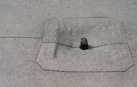 tar felt: Flat roof drain close up. Roll waterproofing. Stock Photo