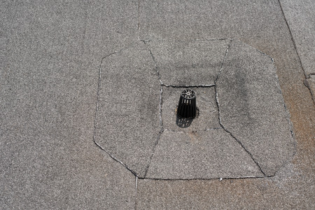 flat roof: Flat roof drain close up. Roll waterproofing. Stock Photo