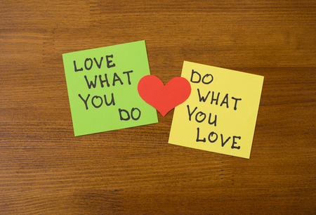 bisiness: Yellow and green note paper with red heart on rustic wooden background. Love What You Do and Do What You Love notes . I love my job concept Stock Photo