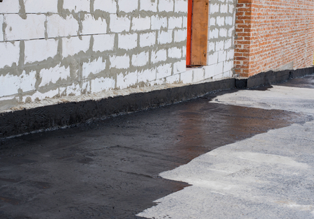 roofing membrane: priming,  concrete screed , and brick wall