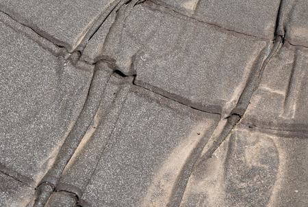 damaged roof:  Damaged insulation layer of the roof. Destruction flat roof due to temperature changes. Damaged waterproofing flat  roof. Crack roofing felt. Damaged  roofing felt. Old roofing felt