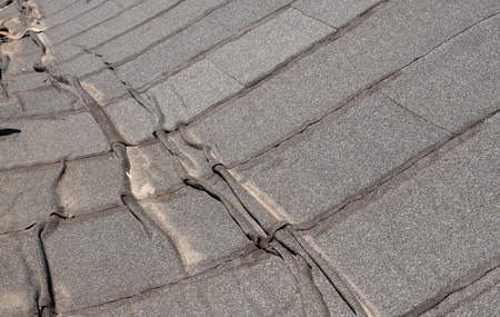 waterproofing material:  Damaged insulation layer of the roof. Destruction flat roof due to temperature changes. Damaged waterproofing flat  roof. Crack roofing felt. Damaged  roofing felt. Old roofing felt