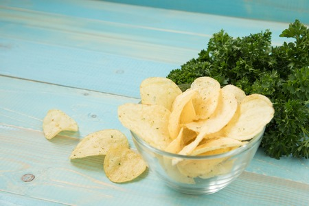 Potato chips with spicy in a glass bowl Stock Photo