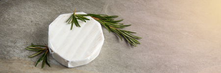 Cheese camembert or brie with fresh rosemary Banco de Imagens